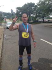 Robert with adventure race medal