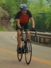 Jim pedalling uphill